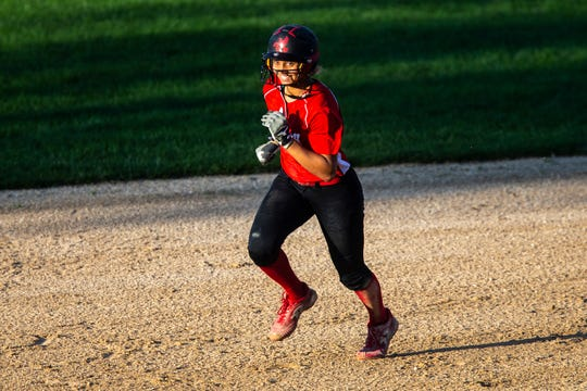 Iowa City High's Ayana Lindsey (42) rounds second after hitting a home run during the Class 5A softball game, Thursday, May 30, 2019, at the City High School in Iowa City, Iowa.