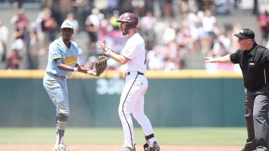 Mississippi State sophomore right fielder Josh Hatcher celebrates a double in the fifth inning of the Bulldogs' win over the Southern Jaguars on Day 1 of the NCAA Tournament.