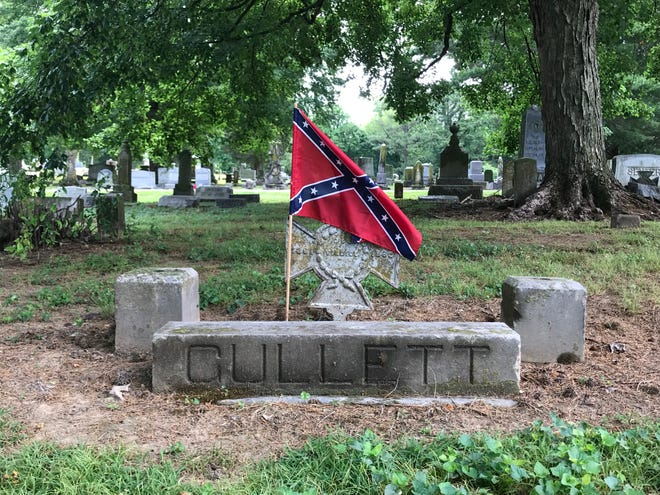 A small Confederate flag flies over the grave and Confederate veteran grave marker of a Confederate soldier at Rose Hill Cemetery in Humboldt, Tenn. on May 30, 2019. Dozens of flags were seen at the cemetery on Memorial Day, though it is not clear when they were placed or who put them there.
