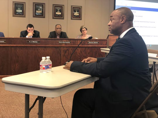 Ray Washington, JMCSS chief operations officer, answers the board's questions during his interview for short-term superintendent Thursday.