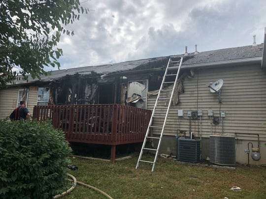 Knox County Rural Metro firefighters extinguished a fire that damaged a condo unit in Powell. No one was home at the time.