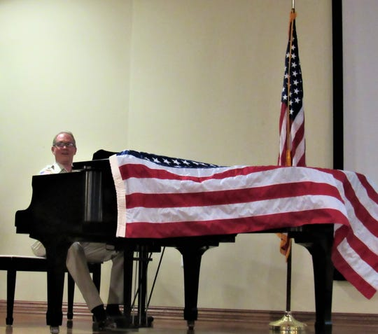"An accomplished pianist, Frank Galbraith led attendees singing ""God Bless America"" during his Memorial Day tribute on May 27 at Sherrill Hills."