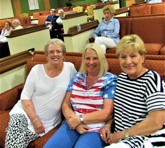 Hilda Haceill, Sharon Maples and Sheena Lindner were among those who came out to listen as Frank Galbraith related events that shaped WWII.