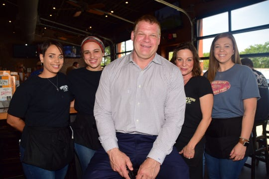 "Mayor Glenn Jacobs takes a pause with Double Dog staffers during an ""Eat and Greet"" session at the eatery in Hardin Valley Friday, May 24. From left: Samatha Varner, Madalyn Torrez,  Jacobs, Wendy Jackson, and Chelsea Purdy."