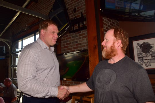 "Knox County Mayor Glenn Jacobs shakes hands with Joshua Bolling during an ""Eat and Greet"" session at Double Dogs in Hardin Valley."