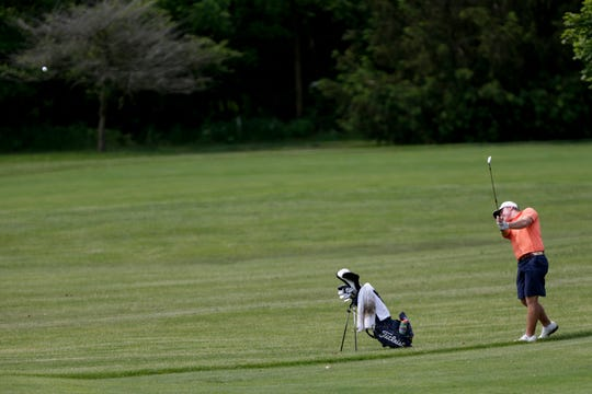 Harrison's Nic Hofman chips on hole 4 during the IHSAA Boys Golf Sectional #5, Friday, May 31, 2019, at Coyote Crossing Golf Course in West Lafayette.