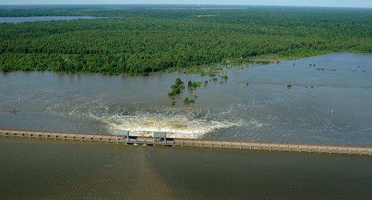 Water from the Mississippi River can be seen passing through three of the open bays of the Morganza Spillway in Louisiana during a flyover on Sunday, May 15, 2011.