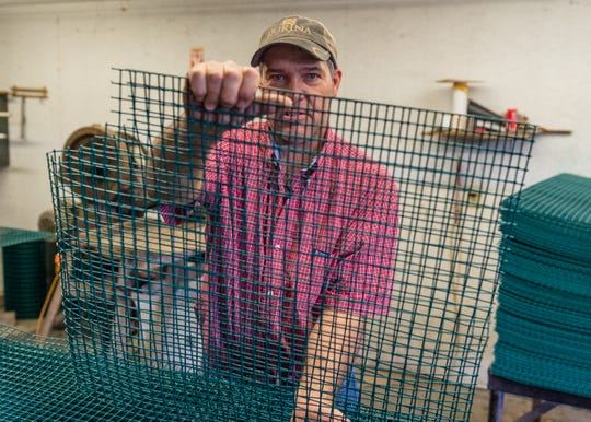 Cary Lee, co-owner of Crawfish Time in Ville Platte, displays some of the Aquamesh netting used in crawfish traps. He, along with his sister Jenny Robins, have been working to farm crawfish since 1999.