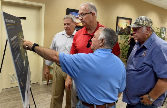 Port Barre Mayor Johnny Ardoin points out the two areas designated as Louisiana Economic Development Certified sites that are now located in the town's industrial park. Looking at the site maps along with Ardoin are town alderman Nelson Barron, St. Landry school board member Donnie Perron and Ken Simmerall with the parish economic development committee.