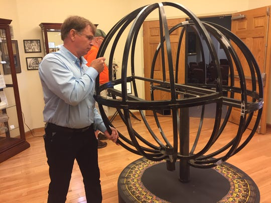City parks superintendent Mike Tharp displays the ball that will rise downtown on New Year's Eve for the Glass Town Countdown celebration.