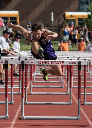 Mount Gilead's Liam Dennis runs in the boys 110-meter hurdles during the Division III state semifinals Friday at the Jesse Owens Memorial Stadium in Columbus, Ohio.