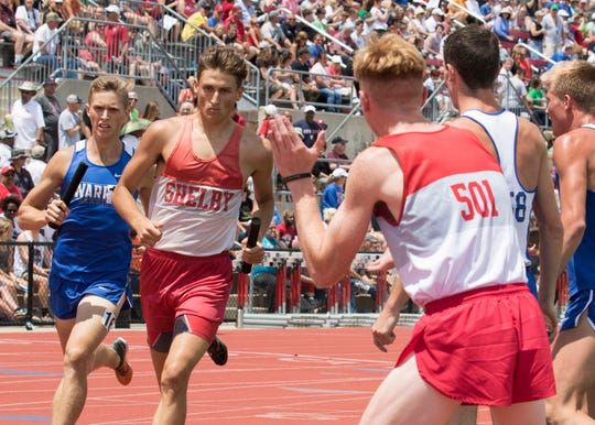 Caleb Brown offers encouragement as anchor Blake Lucius begins the final lap of what became a state championship for Shelby in the Division II 4x800 relay.