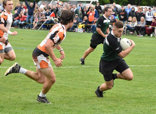 Hunter Nowak carries the ball for Howell in the rugby state championship game against Rockford.