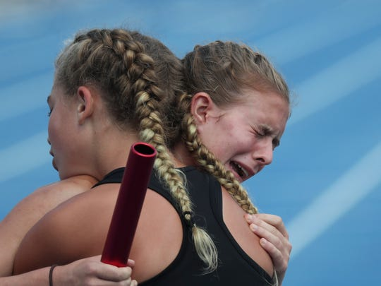 Boyle County's Annabelle Tarter, left, comforts Naia Hutchins after the Girls 4 x 800 Meter Relay during the KHSAA Class 2A Track and Field State Championships in Lexington, KY on May 30, 2019.