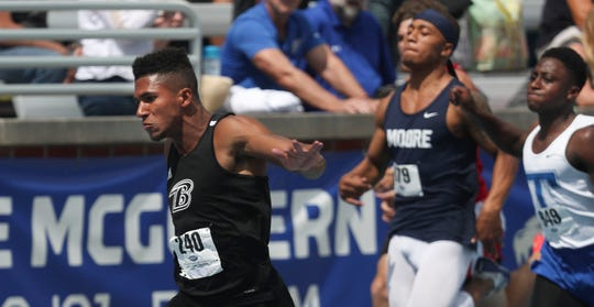 Boyle County's Chris Duff breaks the state record for the 100 Meter Dash during the KHSAA Class 2A Track and Field State Championships in Lexington, KY on May 30, 2019.