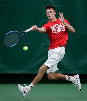 Neenah's Jared Lawatsch hits a forehand during a Division 1 third-round singles match at the WIAA boys tennis state tournament at Nielsen Tennis Stadium on May 31. The Rockets will play in the state team tournament this weekend.