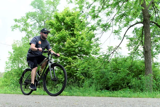 Thomas Thompson, of Shelby, rides on the  Richland B&O Bike Trail in Ontario.