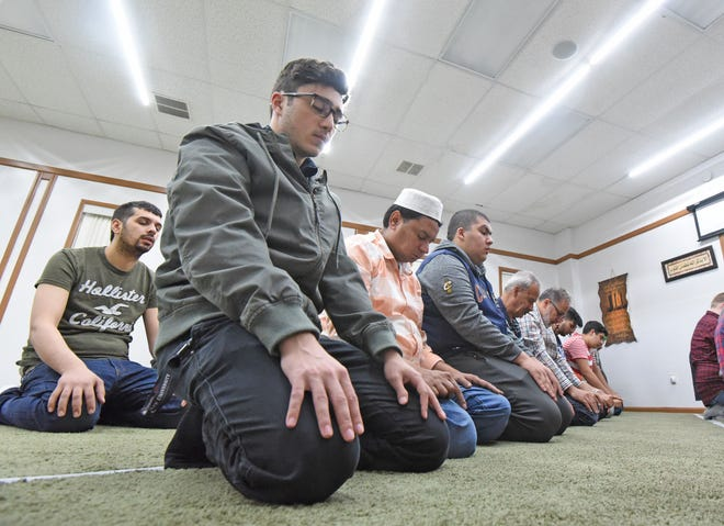 Worshipers at the Islamic Society of Mansfield observe Ramadan in prayer Friday afternoon. Ramadan started on May 5 and concludes in the evening on June 4.