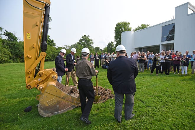 Representative Mark Romanchuk, David Kalish, George Whitten and Mark Taylor break ground Friday at the Mansfield Art Center.
