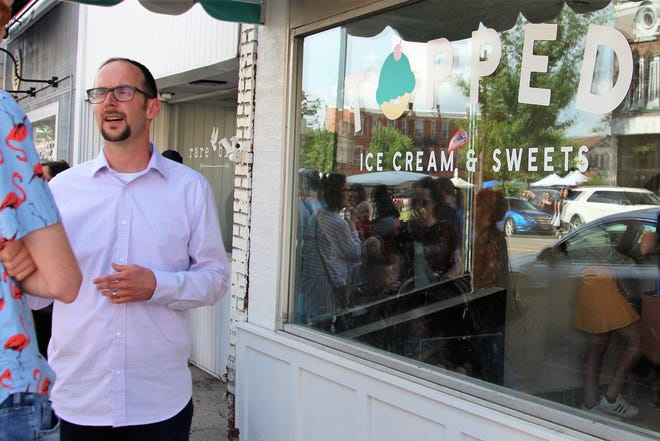 Luke Henry, a part owner of Topped Ice Cream & Sweets, hopes that his location on South Main Street will bring more feet to the streets. The ice cream shop is slated to open next month.
