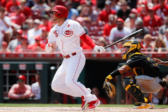 CORRECTS CITY TO CINCINNATI NOT COLUMBUS - Cincinnati Reds' Nick Senzel hits an RBI double off Pittsburgh Pirates starting pitcher Nick Kingham in the fifth inning during the first baseball game of a doubleheader, Monday, May 27, 2019, in Cincinnati. (AP Photo/John Minchillo)