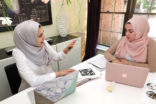 Suha Dweik, left, and Saja Farrah, sisters-in-law and co-owners of Kanzi Store, which sells festive Muslim holiday decorations at Dweik's home where they collaborate on design ideas.