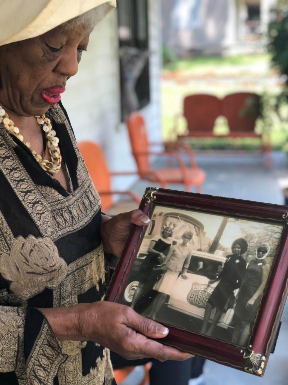 Mary Mitchell, 83, stands on the porch of her home in Orange Mound with a photo taken at Dr. Martin Luther King Jr.'s funeral, which Mitchell attended with friends who posed in front of a police car with civil rights activist Andrew Young inside.