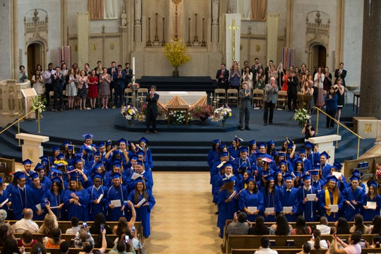 After receiving their diplomas, Cristo Rey Jesuit High School's first graduates turn around to the audience and are instructed to move their tassels to the other side of their cap, marking their official status as graduates.