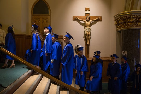 Soon to be graduates of Cristo Rey Jesuit High School line up in the foyer of the Church of the Gesu at Marquette University on Friday. This class marks the first graduating class for Cristo Rey.