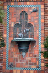 Art Deco fountain on garage.