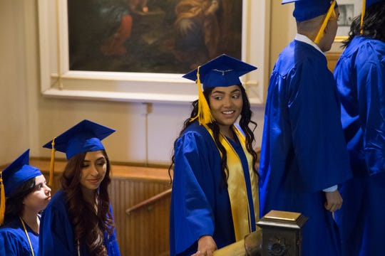 Salutatorian Wendy Gutierrez-Perez waits in the foyer of the Church of the Gesu at Marquette University with the 84 other members of Cristo Rey Jesuit High School's first graduating class in Milwaukee on Friday.