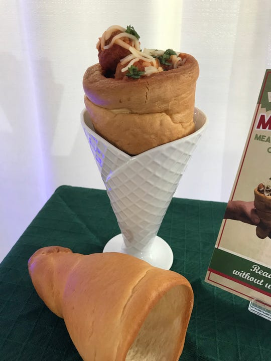 Meatballs with marinara sauce and mozzarella cheese are contained within Italian bread shaped into a cone. Find it at Venice Club near the Harley-Davidson Roadhouse.