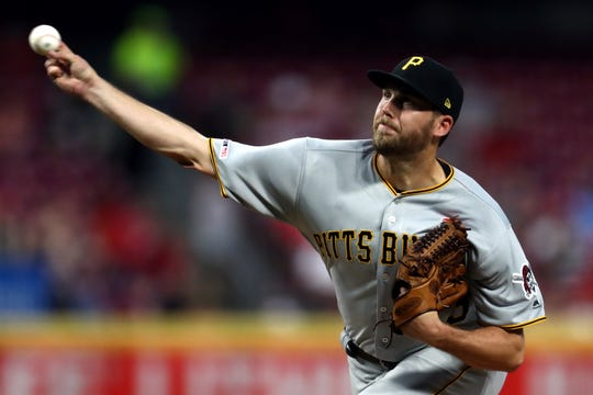 Pittsburgh Pirates relief pitcher Alex McRae pitches against the Cincinnati Reds in the fifth inning Monday at Great American Ball Park.
