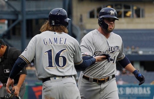 Ben Gamel  greets Mike Moustakas after Moustakas hit  a two-run homer Thursday night  in the first inning at PNC Park.