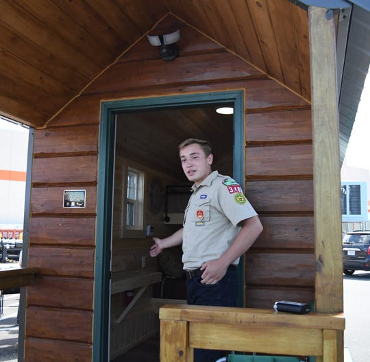 Luke Darracq talks about the mobile micro shelter he built for his Eagle Scout project. The shelter was on display Thursday afternoon at Home Depot in Mountain Home.
