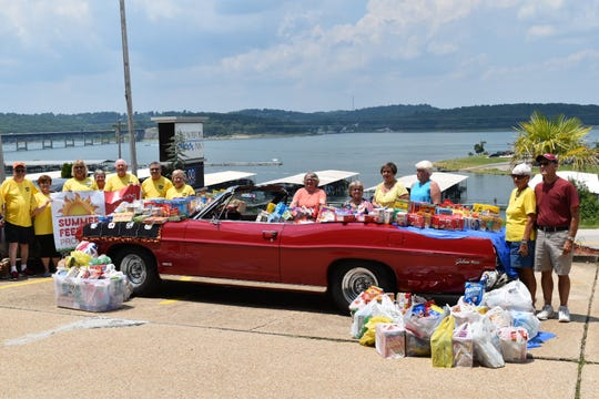 Volunteers from the First United Methodist Church Summer Feeding Program are shown after conducting a food drive.