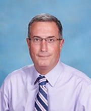 Former Principal Michael Comeau