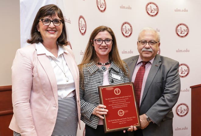Judge Sharon Marchman, left, presented a plaque of appreciation to the University of Louisiana Monroe Marriage & Family Therapy Clinic for 15 years in partnership with the 4th Judicial District Juvenile Drug Court. Dr. Jana Sutton, center, professor and Interim Director of the School of Allied Health, and Dr. Steven Siconolfi, right, Interim Vice President of Academic Affairs, accepted the plaque at a program on Wednesday.