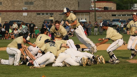 The Roxbury baseball team celebrates after defeating Montville, 3-2, to win its second straight NJSIAA North 1 Group III title.