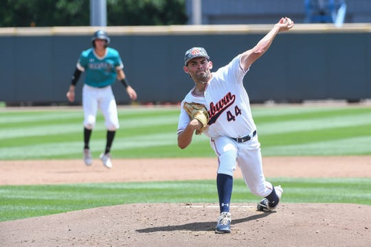 Auburn's Jack Owen (44) pitches against Coastal Carolina during an NCAA Regional on Friday, May 31, 2019, in Atlanta, Ga.