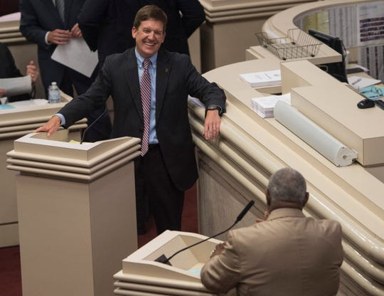 Rep. Bill Poole, the House education budget chair, speaks with Rep. John Rogers on SB 397 during the projected final day of the legislatures spring session at the Alabama State House in Montgomery, Ala., on Friday, May 31, 2019.