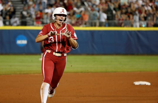 Claire Jenkins rounds the bases after hitting a home run Thursday night to tie the score at 2-2 against Oklahoma in the Women's College World Series.