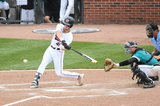 Auburn's Steven Williams (41) hits against Coastal Carolina during an NCAA Regional on Friday, May 31, 2019, in Atlanta, Ga.