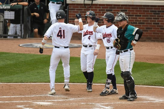 Auburn's Steven Williams (41) celebrates with teammates after hitting a three-run home run against Coastal Carolina during an NCAA Regional on Friday, May 31, 2019, in Atlanta, Ga.