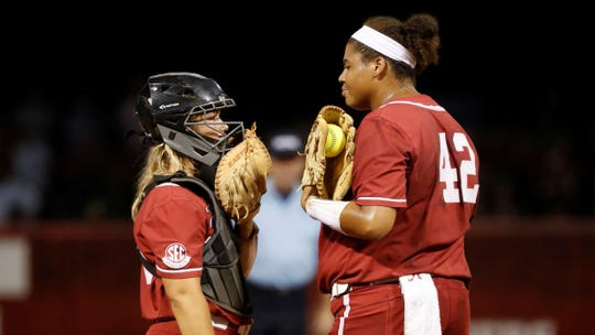 Alabama pitcher Krystal Goodman talks to her catcher from the mound.