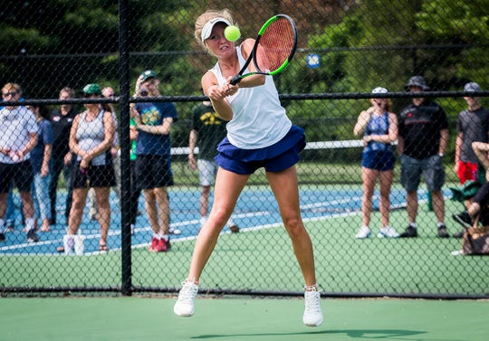Delta's Eleah Snider returns a hit from Cathedral's Ellie Pittman at Carmel High School during their state quarterfinals Friday, May 31, 2019.