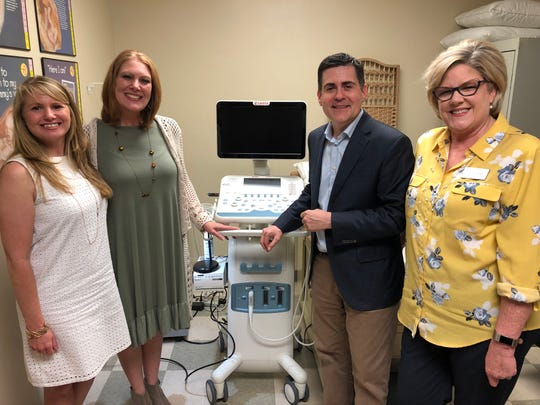 A Southern Baptist ministry donated an ultrasound machine to an Alabama clinic offering abortion alternatives to pregnant women. Russell Moore, the president of the Southern Baptist Convention's Ethics and Religious Liberty Commission, poses alongside Angie Cantrell, Springville Sav-a-Life director; Julie McLendon, executive director of North Jefferson Women's Center; and Lisa Hogan, Vestavia Sav-a-Life director.