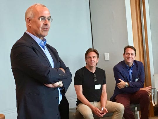 The New York Times columnist David Brooks speaks to about 40 Nashville community leaders May 30, 2019, as noted music producer Dann Huff, center, and Rondal Richardson of the Community Foundation of Middle Tennessee look on.