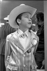 Nine-year-old Little Troy Hess meets fans during the D.J. convention at the Municipal Auditorium on Oct. 17, 1974.