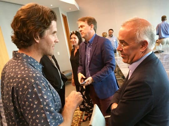 New York Times columnist David Brooks, right, speaks with Miles Adcox, founder of Onsite therapy workshops center, after Brooks spoke to Nashville community leaders about service and civility May 30, 2019.